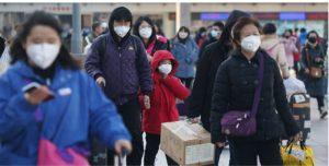 Coronavirus: cinesi con mascherine